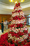 Singapore. Fullerton Hotel. Christmas tree with Santa Claus teddybears.