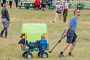 People enter the Arena on the first full day - The 2017 Latitude Festival, Henham Park. Suffolk 14 July 2017