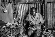 Help can come from unusual sources. The man, a shoemaker, received financial aid to run his shop in a large market in Kisumu, Kenya from a women's micro-business fund. Disabled persons have an even harder time supporting themselves as there is very little private or government funds available.