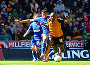 Benik Afobe fouled by Tyrone Mings during the Sky Bet Championship match between Wolverhampton Wanderers and Ipswich Town at Molineux, Wolverhampton, England on 18 April 2015. Photo by Alan Franklin.