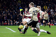 Manchester United defender Luke Shaw (23) crosses during the Premier League match between Burnley and Manchester United at Turf Moor, Burnley, England on 28 December 2019.
