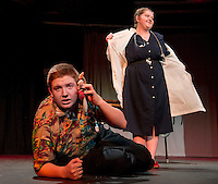 Tom (Shawn Zappala) receives an important phone call while at Dr. Fritz's office during dress rehearsal for Dr. Fritz as part of the Selections from Mere Mortals at Laconia High School to be presented during this weekend's NHETG Drama Festival.  (Karen Bobotas/for the Laconia Daily Sun)