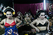 Transvestites prepare for a show in the backstage in Mojokerto, East Java, Indonesia, June 9, 2015.