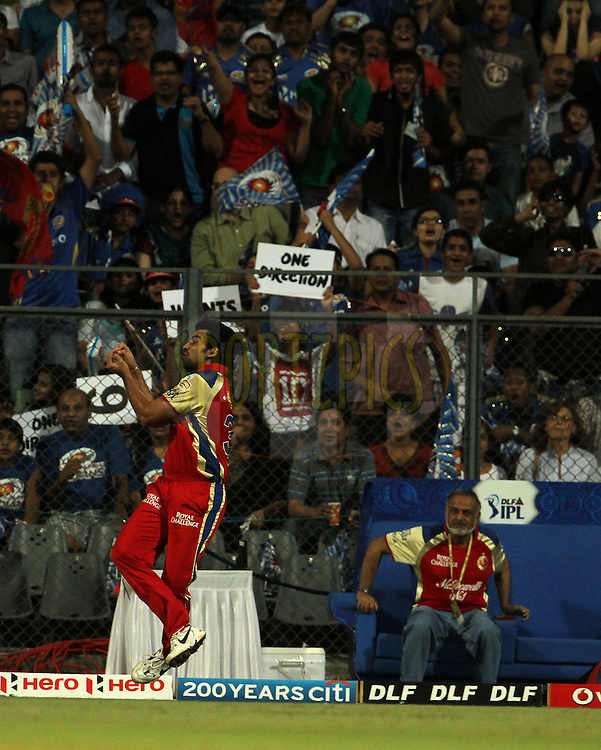 Royal Challengers Bangalore player Zaheer Khan takes a catch during match 54 of the Indian Premier League ( IPL) 2012  between The Mumbai Indians and the Royal Challengers Banglore held at the Wankhede Stadium in Mumbai on the 9th May 2012..Photo by Vipin Pawar/IPL/SPORTZPICS.