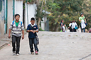 Boys walk back from school in the town of Valle de Angeles, Honduras on Friday April 26, 2013.