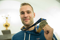 Urh Kastelic posing with his bronze medal after he signed the City of Ljubljana's Golden Book during reception of Slovenian National Handball Men team after they placed third at IHF World Handball Championship France 2017, on January 30, 2017 in City hall, Ljubljana centre, Slovenia. Photo by Vid Ponikvar / Sportida