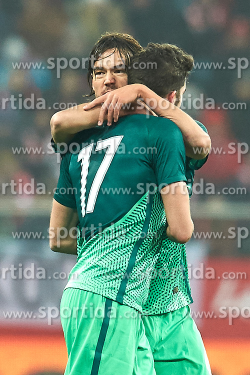 Wroclaw, Poland - 2016 November 14: Miha Mevlja of Slovenia celebrates after scoring with Rene Krhin of Slovenia during Poland v Slovenia - International Friendly Soccer Match at Municipal Stadium on November 14, 2016 in Wroclaw, Poland.<br /> <br /> Adam Nurkiewicz declares that he has no rights to the image of people at the photographs of his authorship.<br /> <br /> Picture also available in RAW (NEF) or TIFF format on special request.<br /> <br /> Any editorial, commercial or promotional use requires written permission from the author of image.<br /> <br /> Mandatory credit:<br /> Photo by © Adam Nurkiewicz / Mediasport