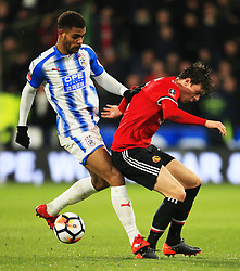 Victor Lindelof of Manchester United and Steve Mounie of Huddersfield Town - Mandatory by-line: Matt McNulty/JMP - 17/02/2018 - FOOTBALL - The John Smith's Stadium - Huddersfield, England - Huddersfield Town v Manchester United - Emirates FA Cup Fifth Round
