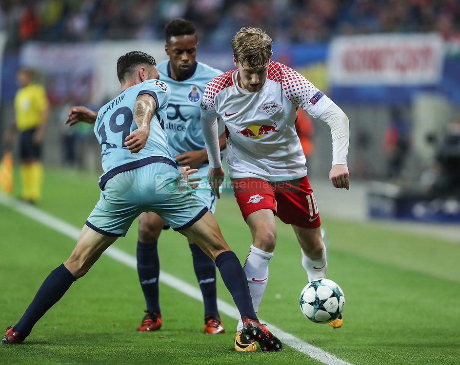 LEIPZIG, Oct. 18, 2017 Leipzig's Emil Forsberg (R) breaks through during a match of Group G of 2017-18 Champions League against Porto in Leipzig, Germany, on Oct. 17, 2017. Leipzig won 3-2. (Credit Image: © Shan Yuqi/Xinhua via ZUMA Wire)