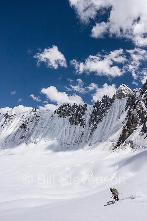 A woman ski mountaineer skiing on the Biafo glacier in the Karakoram Himalaya in Pakistan