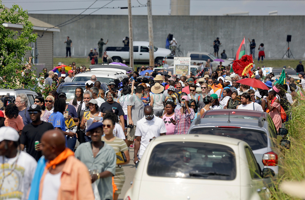 29 August 2015. Lower 9th Ward, New Orleans, Louisiana.<br /> Hurricane Katrina 10th anniversary memorial.<br /> A second line marches away from the levee wall following a memorial to remember those who perished in hurricane Katrina. <br /> Photo credit©; Charlie Varley/varleypix.com.