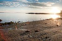 The sun rises over the Pacific Ocean at Vantreight Beach, Victoria, BC
