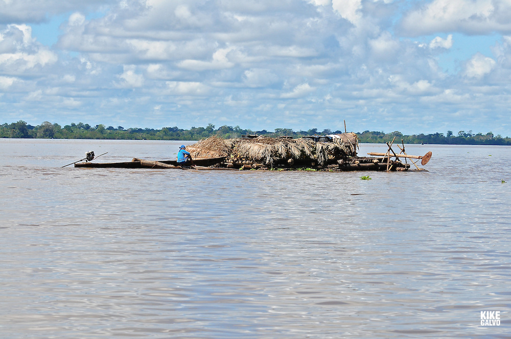 Poor people build floating wood huts on the flooded areas of the Amazon River around Iquitos