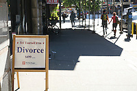 Sign advertising divorce for $499 on 14th Street New York with the words Set Yourself Free