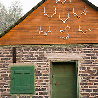 A brick building decorated with antlers in Eastern Oregon in the town of Diamond.