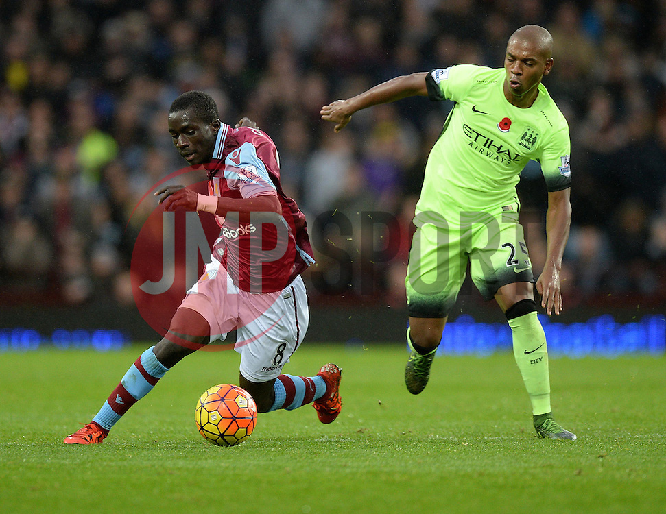 Idrissa Gueye of Aston Villa battles for the ball with  Fernandinho of Manchester City - Mandatory byline: Alex James/JMP - 07966 386802 - 08/11/2015 - FOOTBALL - Villa Park - Birmingham, England - Aston Villa v Manchester City - Barclays Premier League