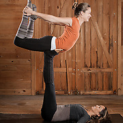 Practicing Acroyoga (or flying yoga) blends elements of yoga, acrobatics, performance and healing arts (usually Thai massage). There are at least two participants in acroyoga: the Base - the individual who has the most points of contact with the ground - and the Flyer - the individual elevated off the ground by the Base. Often times there is also a Spotter watching for safety.