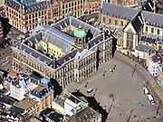 Nederland, Noord-Holland, Amsterdam; 23-03-2020; Dam en Damplein, Paleis op de Dam. Het is ongehoord stil op vrachtauto's en een politieauto na. Geen drommen toeristen of dagjesmensen. Het publieke leven in het centrum van de hoofdstad is bijna geheel stil komen te liggen als gevolg van het Corona virus. Niet alleen is alle horeca dicht, ook veel winkels en andere bedrijven zijn gesloten. Het publiek blijft over het algemeen binnen, de straten en pleinen zijn stil.<br /> Dam square is incredibly quiet, no crowds of tourists or day trippers.<br /> Public life in the center of the capital has come to a complete standstill as a result of the Corona virus. Not only are all pubs, coffee shops and restaurants,  closed, many shops and other companies are also closed. The public generally stays inside, the streets and squares are very quiet.<br /> <br /> luchtfoto (toeslag op standaard tarieven);<br /> aerial photo (additional fee required)<br /> copyright © 2020 foto/photo Siebe Swart