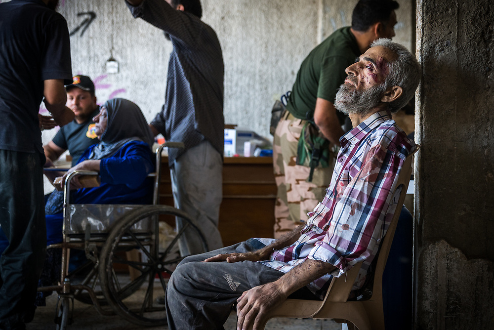 An elderly man receives emergency pre-hospital care at a makeshift field clinic set up inside an abandoned store on the edge of Mosul's Old City, Iraq, on June 21, 2017.<br /> <br /> After several months without enough food, water and fuel while trapped in ISIS-held territory in Mosul's Old City, many civilians showed signs of acute malnutrition.