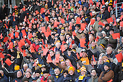 Hull City Fans hold up red cards as a protest at the clubs new membership scheme before during the Sky Bet Championship match between Hull City and Brentford at the KC Stadium, Kingston upon Hull, England on 26 April 2016. Photo by Ian Lyall.