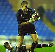 © Peter Spurrier/Intersport Images .Tel + 441494783165 email images@Intersport-images.com.30/11/2003 - Photo  Peter Spurrier.2003/04 Zurich Premiership Rugby - London Irish v Sale Sharks.Michael Horack breaks through Charlie Hodgson's [grounded] tackle