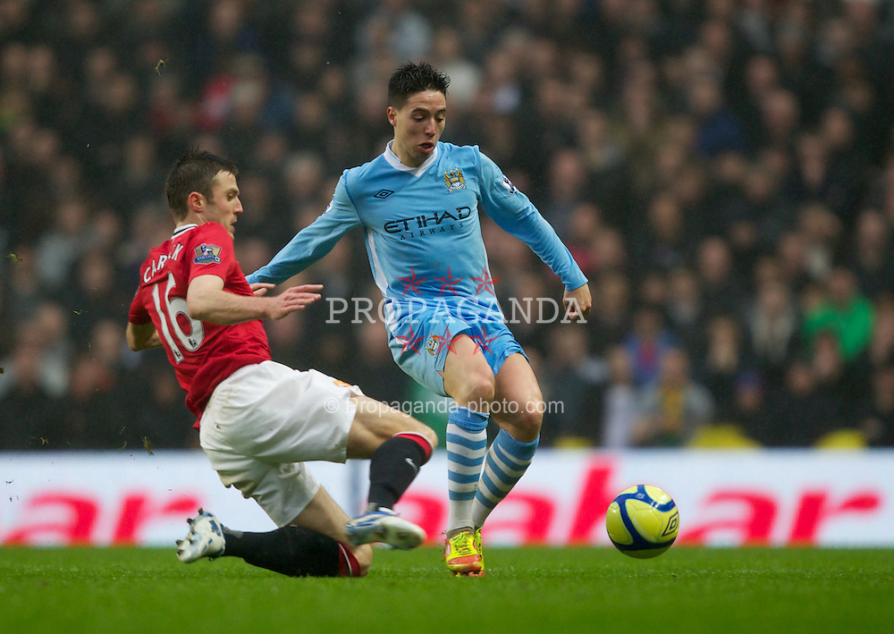 MANCHESTER, ENGLAND - Sunday, January 8, 2012: Manchester City's Samir Nasri in action against Manchester United's Michael Carrick during the FA Cup 3rd Round match at the City of Manchester Stadium. (Pic by Vegard Grott/Propaganda)