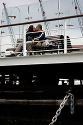 ITALY GENOA 22OCT08 - A couple kiss in the port of Genoa, Italy...jre/Photo by Jiri Rezac..© Jiri Rezac 2008..Contact: +44 (0) 7050 110 417.Mobile:  +44 (0) 7801 337 683.Office:  +44 (0) 20 8968 9635..Email:   jiri@jirirezac.com.Web:    www.jirirezac.com..All images © Jiri Rezac 2008. All rights reserved.