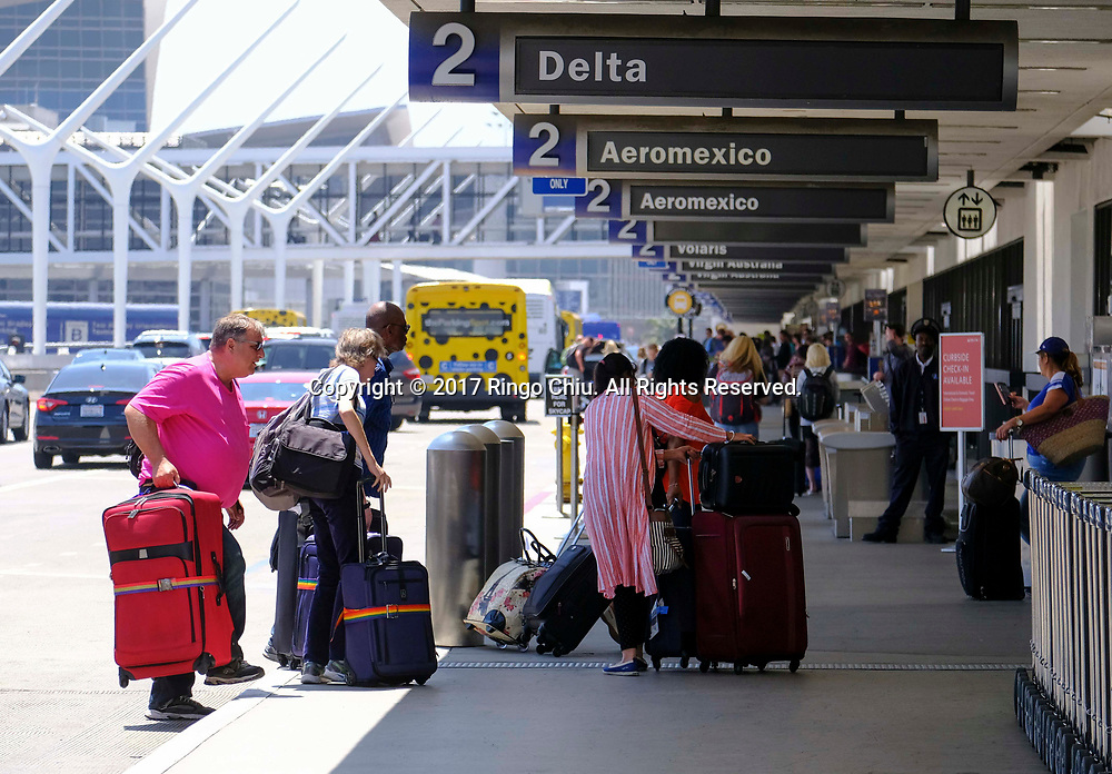 Holiday travelers arrive at Los Angeles International Airport on Friday, June 30, 2017 in Los Angeles. (Photo by Ringo Chiu)<br /> <br /> Usage Notes: This content is intended for editorial use only. For other uses, additional clearances may be required.
