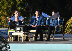 Kevin Jonas, Nick Jonas, and Joe Jonas film their first music video together since reuniting as The Jonas Brothers. The trio was seen filming on the rooftop of the historic International Inn, before doing a scene on a sailboat in Miami Beach, Florida. 24 Mar 2019 Pictured: Joe Jonas, Nick Jonas, Kevin Jonas. Photo credit: MEGA TheMegaAgency.com +1 888 505 6342