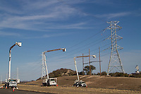 Installation of 345KV CREZ transmission lines for renewable power near Junction, TX.