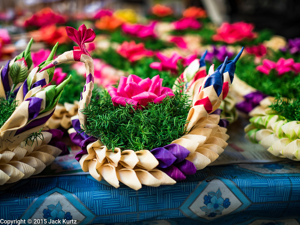 """24 NOVEMBER 2015 - BANGKOK, THAILAND:  """"Krathongs"""" for sale in Bang Chak Market. Krathongs are small boats Thais float in canals and bodies of water, on Loy Krathong, a Buddhist holiday on the full moon in November.  The Bang Chak Market serves the community around Sois 91-97 on Sukhumvit Road in the Bangkok suburbs. About half of the market has been torn down. Bangkok city authorities put up notices in late November that the market would be closed by January 1, 2016 and redevelopment would start shortly after that. Market vendors said condominiums are being built on the land.        PHOTO BY JACK KURTZ"""