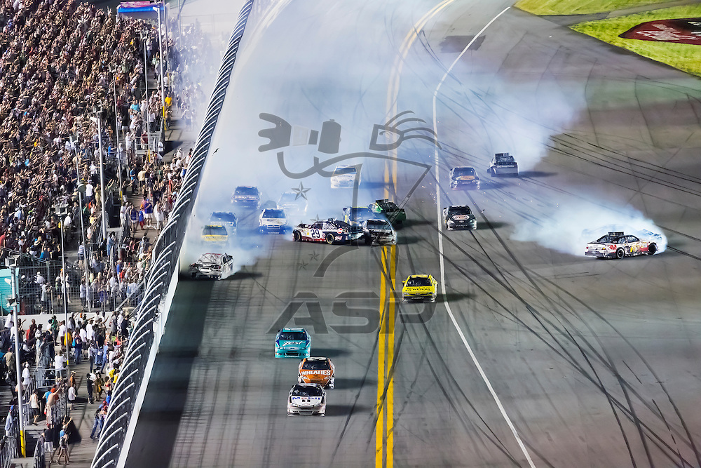DAYTONA BEACH, FL - JUL 07, 2012:  Holding off the rest of the field, Tony Stewart (14) crosses the finish line first to win the Coke Zero 400 at the Daytona International Speedway in Daytona Beach, FL.
