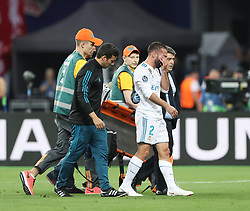 May 26, 2018 - Kiev, Ukraine - Real Madrid's Dani Carvajal, in the center, leaves the field with medics during the final match of the Champions League between Real Madrid and Liverpool at the Olympic Stadium in Kiev. Ukraine, Saturday, May 26, 2018  (Credit Image: © Raddad Jebarah/NurPhoto via ZUMA Press)
