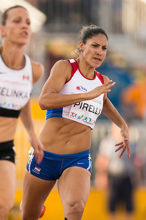 Camila Pirelli of Paraguay runs in the 200 metre event of the women's heptathlon competition at the 2015 Pan American Games at CIBC Athletics Stadium in Toronto, Canada, July 24,  2015.  AFP PHOTO/GEOFF ROBINS