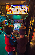 Garden City, New York, USA. December 12, 2015. L-R, DANIEL TORRES, 5, and NATHANIEL PEREZ, 4, play the 1988 arcade game Double Dragon II: The Revenge, by Technos/Romstar, during Opening Day of Arcade Age exhibit, in an arcade set up at Cradle of Aviation Museum in Long Island. Admission includes unlimited free pay-to-play of video arcade games. Exhibit runs from Dec. 12, 2015 through April 3, 2016.