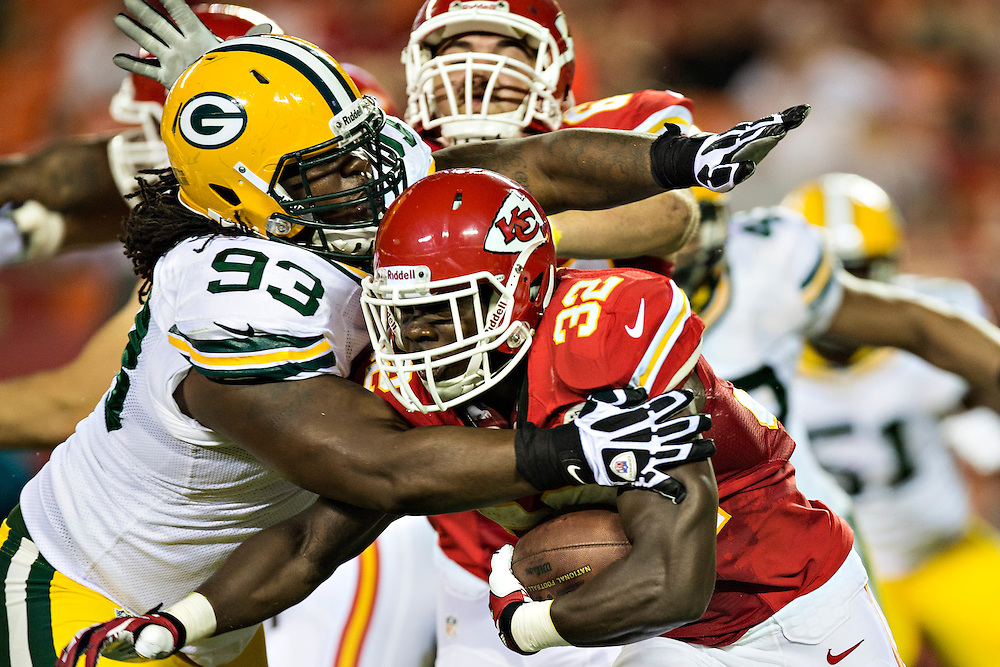 KANSAS CITY, MO - AUGUST 29:  Cyrus Gray #32 of the Kansas City Chiefs is tackled by Josh Boyd #93 of the Green Bay Packers during the last preseason game at Arrowhead Stadium on August 29, 2013 in Kansas CIty, Missouri.  (Photo by Wesley Hitt/Getty Images) *** Local Caption *** Cyrus Gray; Josh Boyd