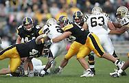 17 NOVEMBER 2007: Western Michigan running back Brandon West (2) is hit by Iowa linebacker Mike Klinkenborg (40) and defensive lineman Matt Kroul (53) in Western Michigan's 28-19 win over Iowa at Kinnick Stadium in Iowa City, Iowa on November 17, 2007.