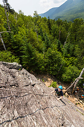 Owen Tuttle rock climbing on Square Ledge in New Hampshire's White Mountains.
