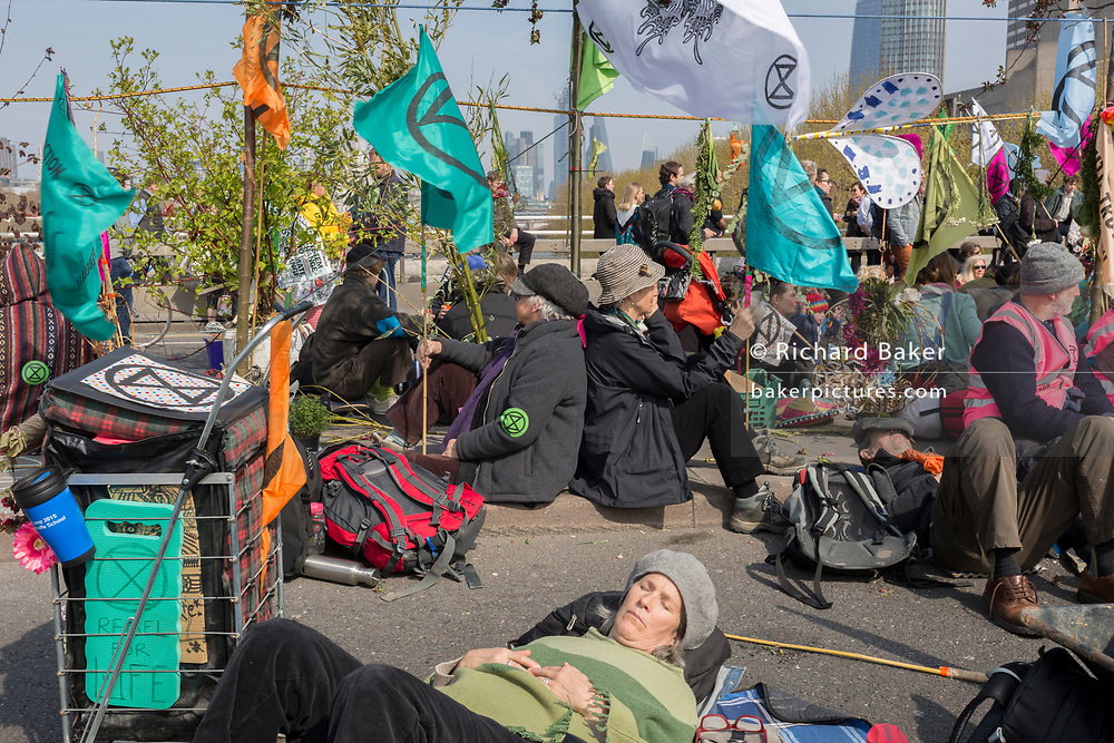 Climate Change protestors with Extinction Rebellion block Waterloo Bridge and simultaneously stop traffic across central London including Marble Arch, Piccadilly Circus, Waterloo Bridge and roads around Parliament Square, on 15th April 2019, in London, England.