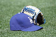 LOS ANGELES - MAY 30:  A baseball glove and cap sit on the grass prior to the game between the Colorado Rockies and the Los Angeles Dodgers on Monday, May 30, 2011 at Dodger Stadium in Los Angeles, California. The Dodgers won the game 7-1. (Photo by Paul Spinelli/MLB Photos via Getty Images)