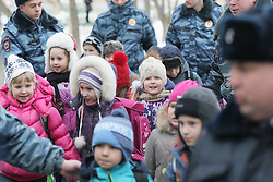 61009839<br /> Police escort children out of a school in northeast Moscow, where a high-school student took fellow pupils hostage and shot a teacher and a police officer dead. The teenager has been detained, Moscow, Russia, Monday, 3rd February 2014. Picture by  imago / i-Images<br /> UK ONLY