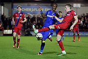 AFC Wimbledon striker Tom Elliott (9) battles for possession with Rochdale defender Jim McNulty (4) during the EFL Sky Bet League 1 match between AFC Wimbledon and Rochdale at the Cherry Red Records Stadium, Kingston, England on 28 March 2017. Photo by Matthew Redman.