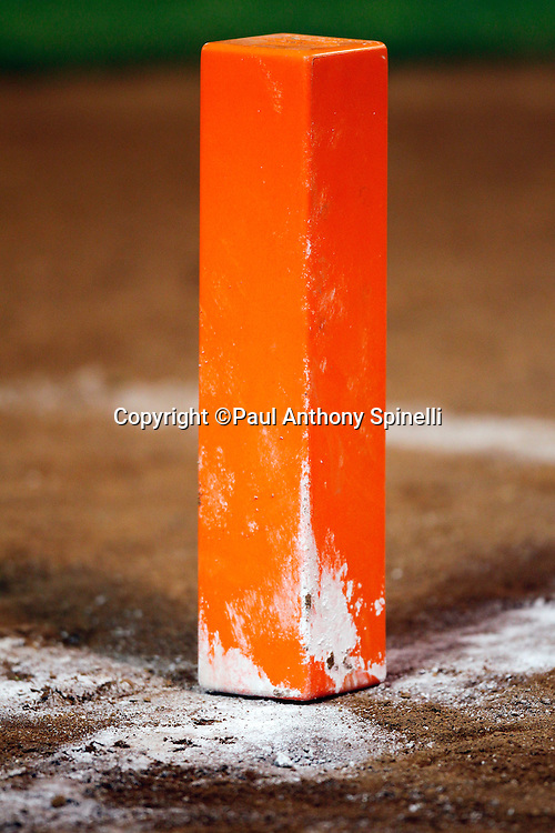 An end zone pylon sits on a pile of chalk while ready for the Oakland Raiders NFL preseason week 3 football game against the San Francisco 49ers on Saturday, August 28, 2010 in Oakland, California. The 49ers won the game 28-24. (©Paul Anthony Spinelli)