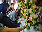 03 NOVEMBER 2014 - YANGON, MYANMAR: Shia women in Punja Mosque pray at a shrine representing Hussein bin Ali's coffin during the celebration of Ashura. Shia Muslims in Yangon started the celebration of Ashura Monday. Ashura commemorates the death of Hussein ibn Ali, the grandson of the Prophet Muhammed, in the 7th century. Hussein ibn Ali is considered by Shia Muslims to be the third Imam and the rightful successor of Muhammed. He was killed at the Battle of Karbala in 610 CE on the 10th day of Muharram, the first month of the Islamic calendar. According to Myanmar government statistics, only about 4% of Myanmar is Muslim. Many Muslims have fled Myanmar in recent years because of violence directed against Burmese Muslims by Buddhist nationalists.    PHOTO BY JACK KURTZ