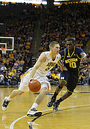 February 19 2011: Iowa Hawkeyes guard Matt Gatens (5) tries to drive around Michigan Wolverines guard Tim Hardaway Jr. (10) during the first half of an NCAA college basketball game at Carver-Hawkeye Arena in Iowa City, Iowa on February 19, 2011. Michigan defeated Iowa 75-72 in overtime.