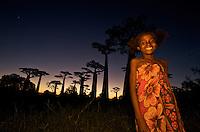 Woman at Avenue of the Baobabs Grandidiers Baobab ( Adansonia Grandidieri ), Morondava, Madagascar Image by Andres Morya