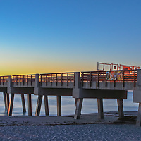 South Florida sunrise panorama photography of Juno Pier and beach in Palm Beach County, FL. This Florida Juno Fishing Pier panorama photography image is available as museum quality photography prints, canvas prints, acrylic prints or metal prints. Fine art prints may be framed and matted to the individual liking and decorating needs:<br />