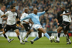 MANCHESTER, ENGLAND - Saturday, March 27, 2004: Manchester City's Nicolas Anelka and Fulham's Martin Djetou during the Premiership match at the City of Manchester Stadium. (Pic by David Rawcliffe/Propaganda)