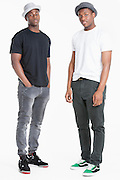 Portrait of two young African American men in casuals over gray background