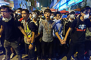 Students facing Police in riot gear and about to charge <br /> <br /> Another night of chaotic clashes with police in Mongkok<br /> <br /> 21st day of pro-democracy protest in Hong Kong.<br /> <br /> The mass rallies are one of the biggest challenges to Beijing's authority since the Tiananmen pro-democracy protests of 1989
